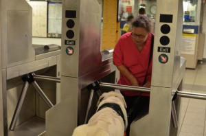 Stamm navigating a subway turnstile with Wargas.
